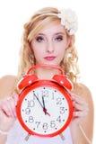 Woman bride holding big red clock Stock Photos