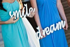 Bride maids in colorful blue dresses, smile and dream. royalty free stock photography