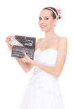 Woman bride with one dollar. Wedding expenses. Stock Image