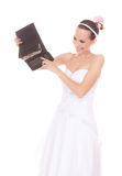 Woman bride with one dollar. Wedding expenses. Royalty Free Stock Image