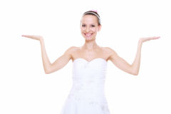 Woman bride showing open hand copy space for product Stock Photos