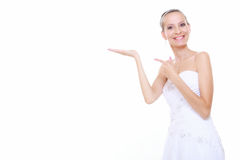 Woman bride showing open hand copy space for product Stock Photo