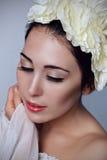 Woman bride wearing flower white wreath. Wedding make-up. Stock Photos