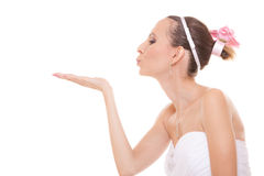 Woman bride in white wedding dress blowing a kiss. Stock Photography