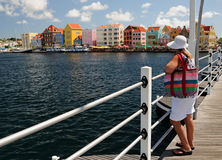 Woman on the Bridge. Middle-aged woman on a bridge overlooking a colorful downtown Stock Photography