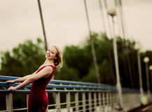 Woman on the bridge Royalty Free Stock Image