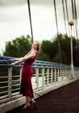 Woman on the bridge Stock Photos