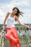 Woman on the bridge. Beautiful woman standing on the bridge Royalty Free Stock Images