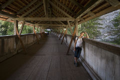 A woman on a bridge Stock Photography
