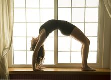 Woman in bridge pose, yoga position royalty free stock photos