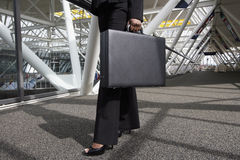 Woman with Briefcase. Close up of a businesswoman's legs and briefcase as she strides through an office lobby. Horizontally framed shot royalty free stock photos