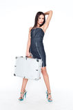 Woman with Briefcase. A glamorous woman with a white briefcase, posing on white studio background royalty free stock photo