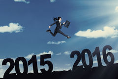 Woman with briefcase leaps on the air Stock Photo