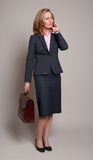 Woman with briefcase and mobile phone Royalty Free Stock Photos