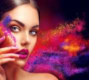 Woman with bright color makeup Stock Image