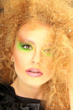 Woman with bright colored makeup and curly hairstyle Stock Photo
