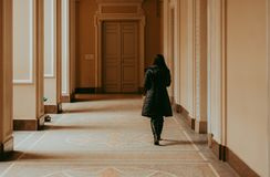 Woman in bright corridor royalty free stock images