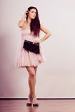 Woman bright dress heeled shoes clutch in hand Royalty Free Stock Photography