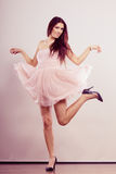 Woman in bright dress and high heels shoes dancing Royalty Free Stock Image