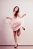 Woman in bright dress and high heels shoes dancing Stock Photography