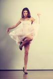 Woman in bright dress and high heels shoes dancing Stock Photo