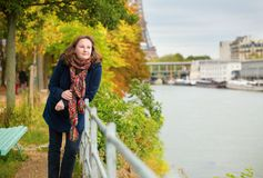 Woman on a bright fall day in Paris Stock Photos