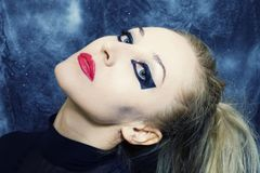Woman with bright gothic makeup Stock Photo
