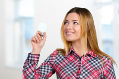 Woman with a bright idea Stock Photo