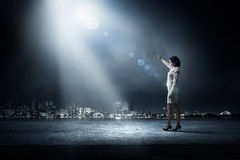 Woman in bright light Stock Photos