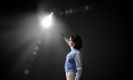 Woman in bright light Royalty Free Stock Photos