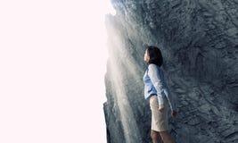 Woman in bright light Stock Photo