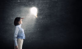Woman in bright light Stock Image