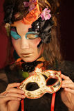 Woman with bright make up with carnaval mask Stock Photography