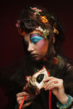 Woman with bright make up with carnaval mask Royalty Free Stock Image
