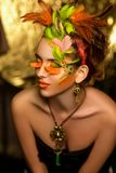 Woman bright make up. Creative make-up, new conceptual idea for Halloween. orange green bold body art painting. Crazy graphic abstract picture, woman face Stock Image