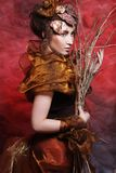 Woman with bright make up with dry branches Royalty Free Stock Photo
