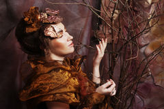 Woman with bright make up with dry branches Royalty Free Stock Image