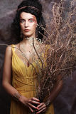 Woman with bright make up with dry branches Royalty Free Stock Photos