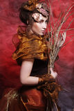 Woman with bright make up with dry branches Stock Photo
