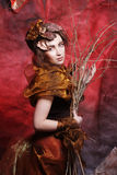 Woman with bright make up with dry branches Stock Photography