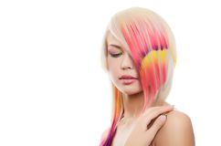 Girl with a bright make-up and multi-coloured strand in hair Stock Photography