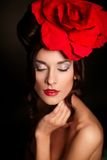 Woman with bright makeup with big red rose on head Royalty Free Stock Photography