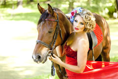 Woman with bright makeup on the horse outdoors Stock Photography