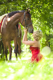 Woman with bright makeup on the horse outdoors Stock Photos