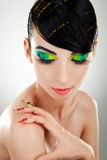 Woman with  bright manicure and makeup Stock Images