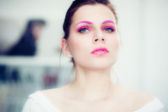 The woman with a bright pink make-up. Royalty Free Stock Image