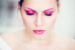 The woman with a bright pink make-up. Stock Image