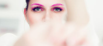 The woman with a bright pink make-up. Stock Photography
