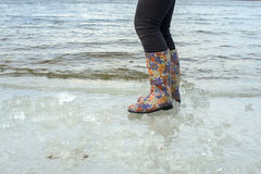 Woman in bright rubber boots. Stock Photography