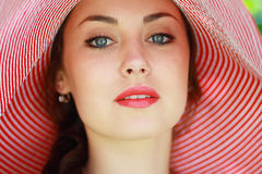 Woman in bright summer hat Stock Images